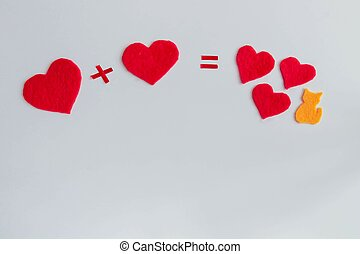 Arithmetic of love. Example with hearts on a white background