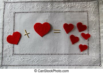 Arithmetic of love. Example with hearts on a white napkin with embroidery