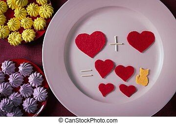 Arithmetic of love. Sweet table with hearts on a plate