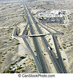 Aerial view of interstate 10 in southwest desert landscape of Arizona.