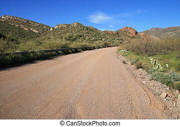 Arizona dirt road - Arizona rural dirt road with distant ...