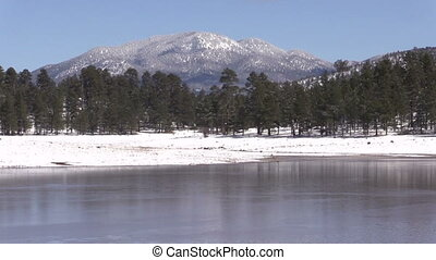 Arizona Lake in Winter - a snow covered landscape of kaibab...