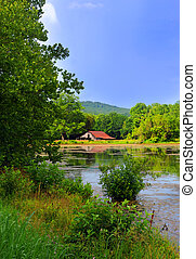 Arkansas Barn Scene - Tranquil waters of a large pond ...