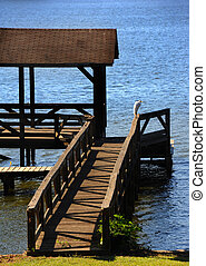 Arkansas Crane - White crane sits on wooden railing of a ...