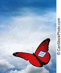 Arkansas flag butterfly flying on sky background