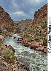 Arkansas river in Royal Gorge with train running parallel. ...
