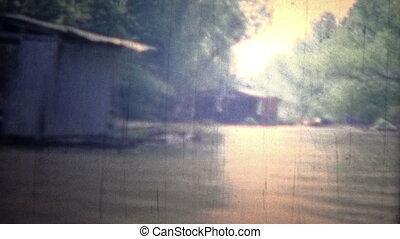 ARKANSAS, USA - 1965: Floating boat