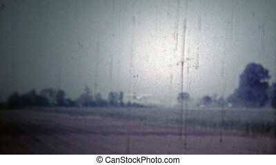 ARKANSAS, USA - 1966: Airplane crop - Original vintage 8mm...