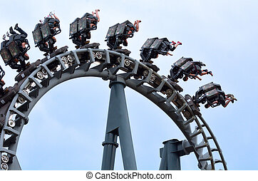 GOLD COAST, AUS - NOV 06 2014:Visitors ride on Arkham Asylum ? Shock Therapy in Movie World Gold Coast Queensland Australia. It was the first steel inverted roller coaster at an Australian theme park.
