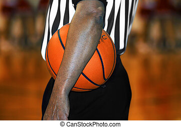 Arm Across Basketball - Referee, at high school basketball...
