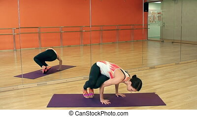 Arm Balance Pose - Front view of yoga practitioner...