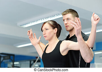Arm & chest stretching with personal trainer