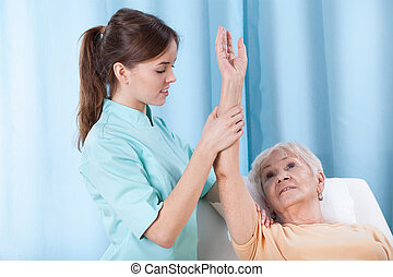 Arm rehabilitation on treatment couch - Closeup of arm...