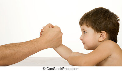 Arm-wrestling - Boy with father easy wrestling