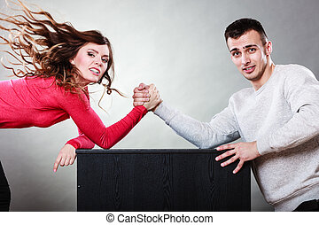 Arm wrestling challenge between young couple - Partnership...