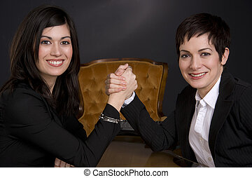 Arm Wrestling - Two business partners have an arm wrestling...