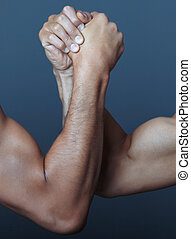 Arm wrestling - Two hands doing arm wrestling