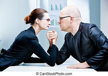 arm wrestling woman VS man - arm wrestling business woman VS...