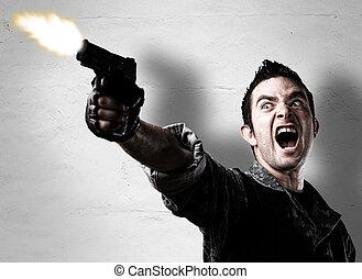 arma de fuego de tiroteo, hombre