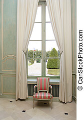 armchair close to window - armchair close to a window at the...