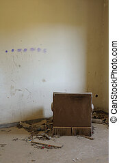 armchair facing the wall