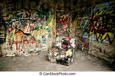armchair in a destroyed interior of house