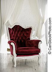 Armchair in an empty room
