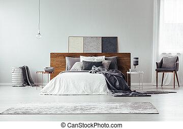 Armchair in bright bedroom interior
