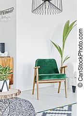 Armchair in room corner