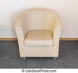 Armchair near wall