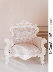 Armchair on wall background