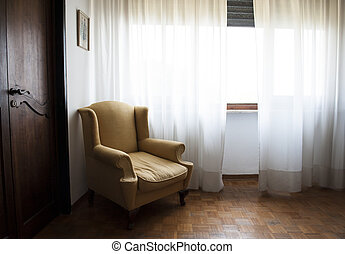 Armchair - A brown armchair in an old apartment with wooden...