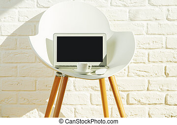 Armchair with empty laptop