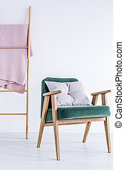Armchair with grey pillow