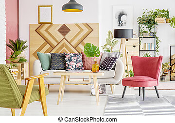Armchairs, sofa and wooden wall
