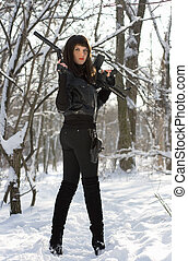 Armed attractive young woman