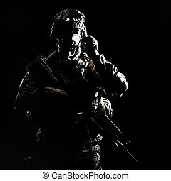 Armed infantryman during night military operation