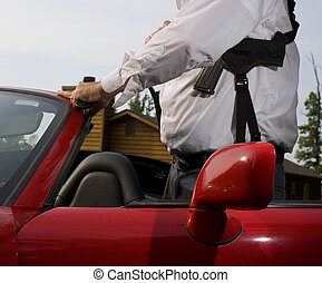 Armed - Man getting out of a red convertible with a shoulder...