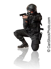 Armed man in protactive cask with a pistol. Isolated on white.