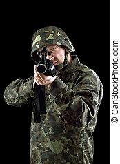 Armed man pointing a gun