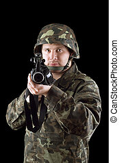 Armed man pointing a rifle