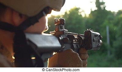 Armed man taking aim. Airsoft