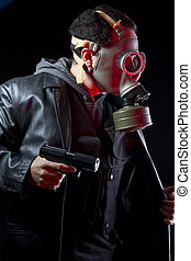 Armed man with gas mask and gun