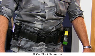 Armed officer with two guns - Close up of a holster with two...