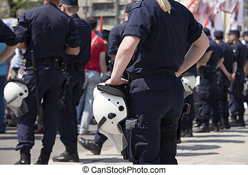 armed police - Police on duty during a street protest