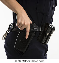 Armed policewoman. - Close up side view of mid adult female...