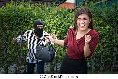 Armed robber and victim with a handbag/Woman ran to escape the bandits