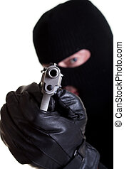 Armed Robber - Masked man with handgun shot on white...
