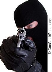 Armed Robber - Masked man with handgun shot on white...