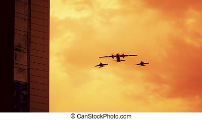 Armed russian fighter jets on the red sunset background.